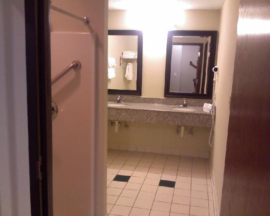 Comfort Suites East : A view from the first bedroom area to the bathroom sinks, shower is on the left.