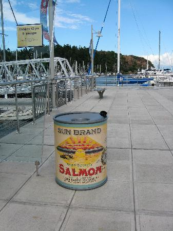Charming Anacortes waterfront walkway with garbage cans inspired by old can labels.
