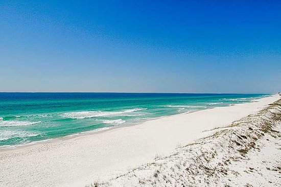 White sand and emerald waters in Panama City Beach.