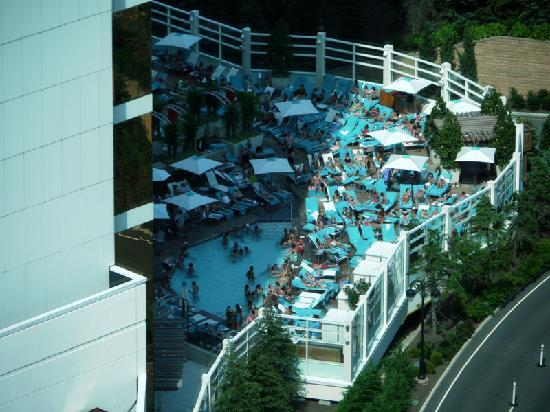 The Water Club by Borgata : 3PM shadw falls on ahlf the cramped guests at Water Club pool.