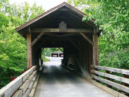 Sevierville, TN: End view of Harrisburg Covered Bridge with marker