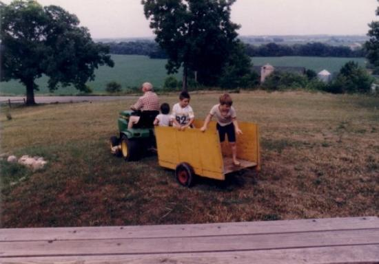 lake mills childhood riding back of the old lawn tractor wagon w