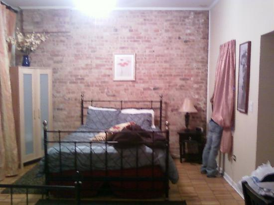 Wicker Park Inn: The main bed area (my stuff on the bed and friend in the window)