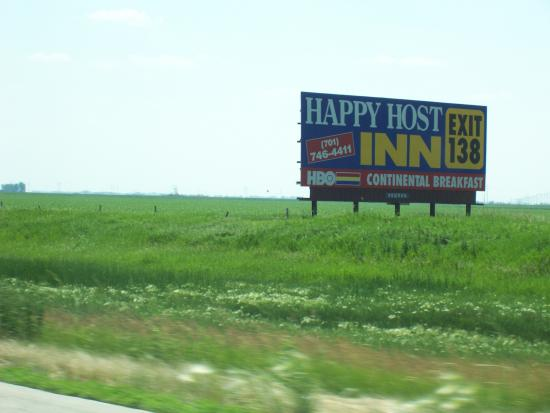 Happy Host Inn: Sign before entering Grand Forks.