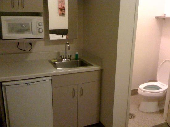 "Hotel Occidental : The ""kitchenette/bathroom"" combo, otherwise known as the kitchen from hell. I was hoping to have"