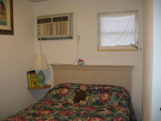 Tiny Bedroom Full Sized Bed Noisy Old A C Unit And No