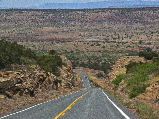 Santa Fe, Nuevo Mexico: New Mexico hwy 104 in the canyons...took pics while riding the Harley; loved this long road.