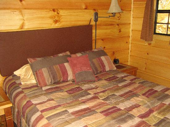 Dancing Sun Cabins: The bedroom in the Moondance