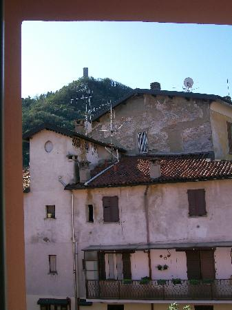 Hotel Larius: view from the window (zoomed to show the tower on the hill-the houses are not that close.  There