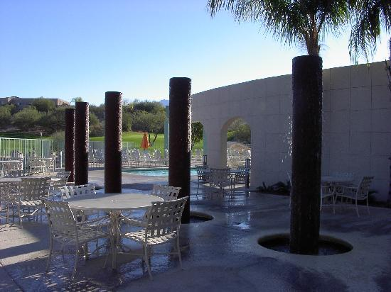 The Golf Villas at Oro Valley: water runs down around these poles, the pool is in the background