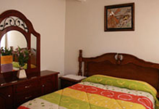 El Hogar de Carmelita: double bed