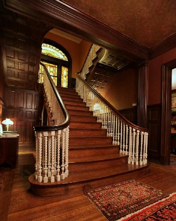 grand staircase splits into double stair at landing