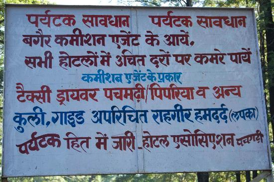 Signboard in Pachmarhi warning tourists about touts