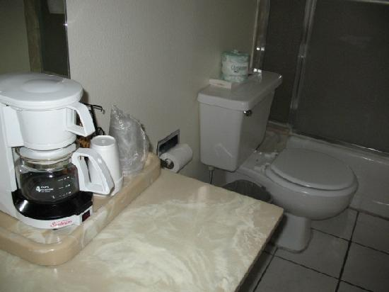 Estero Bay Motel: Coffee maker and toilet occupying the same space.