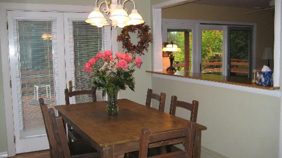 Country Home kitchen has French Doors leading to a deck & hot tub. Provided by: Healdsburg Country Gardens