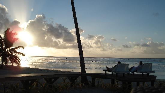 Aitutaki Escape: Sunsets on the private jetty and lounge chairs