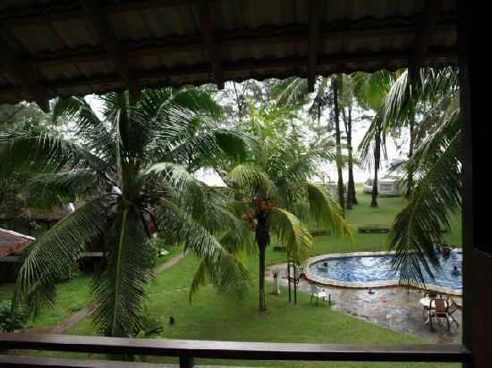 ‪‪Duta Sands Beach Resort‬: View from room, can see the beach. Small pool. Old caravans.‬