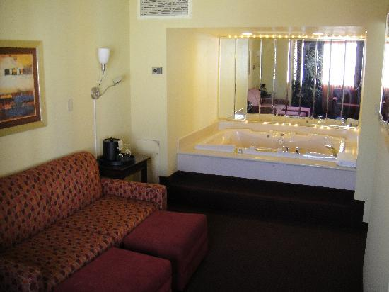 Living room and jacuzzi picture of four queens hotel and for Sitting room suites