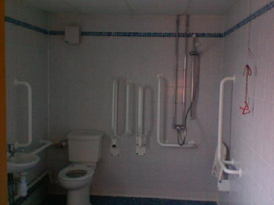 How to design a football room joy studio design gallery - Disabled shower room ...