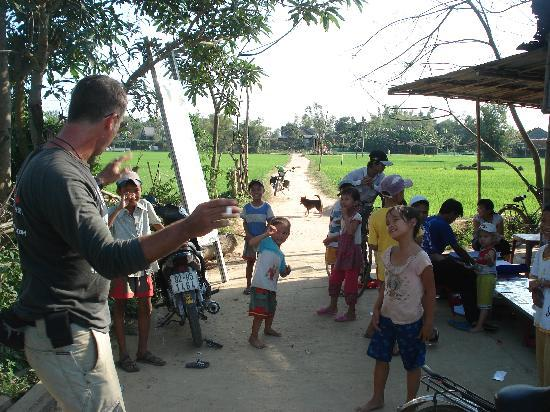 Adventures day tours guide aussie adam entertaining the locals