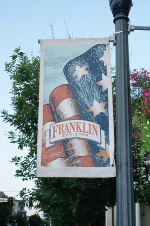 Franklin, TN: 15 min south of Nashville...retardly American but quaint