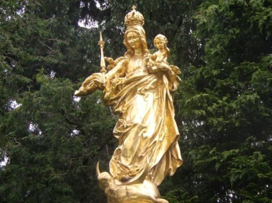 A gold statue outside the church - Picture of ...