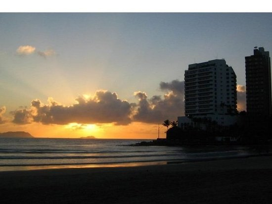 Guaruja, SP: *Sunset in Asturias Beach!*  Can you see? The sun is shining on me. It makes me feel so free. S
