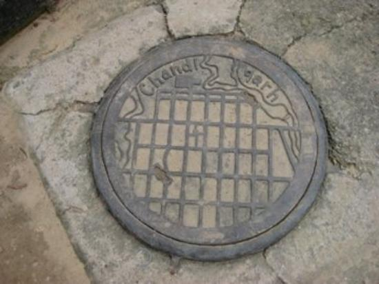 Chandigarh, India: On the manhole cowers in Chandigath has a map of the city, a planned city - Very