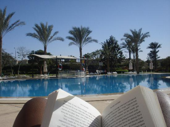 Novotel Cairo 6th Of October: Me reading at the queit pool