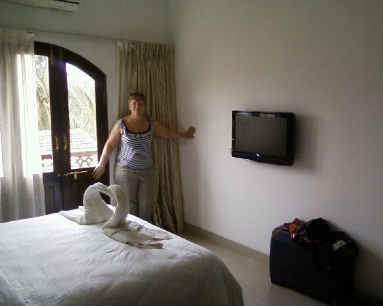 Calangute Grande: My wife in our deluxe room.