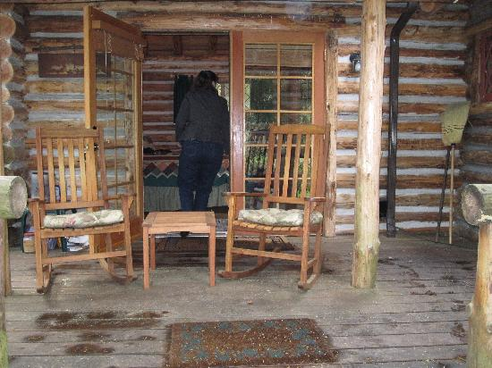 Guest House Log Cottages: side porch off bedroom
