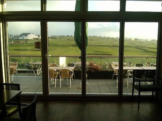 : view out onto the sun terrace and golf course