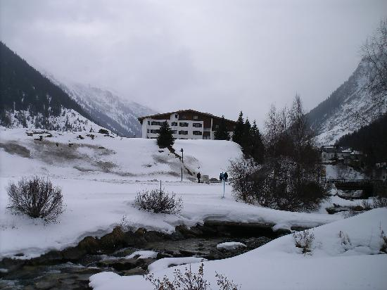 Galtür, Austria: View of the hotel from the river.