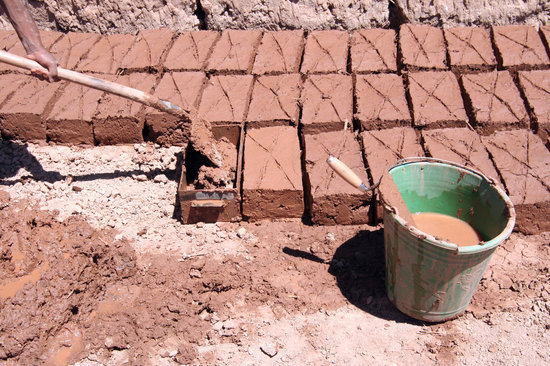 Ait Ben Haddou making bricks the traditional way