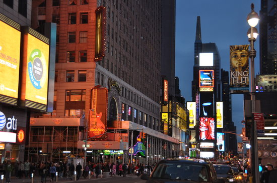 New York by, NY: Times Square at dusk