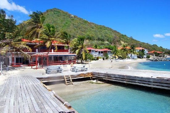 Fort Recovery Beachfront Villa & Suites Hotel: Spectacular private villas on small, secluded sandy beach...