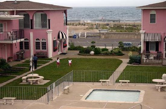 from across the street picture of periwinkle inn cape. Black Bedroom Furniture Sets. Home Design Ideas