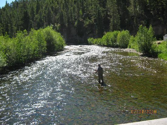 Fly fishing in the south fork of the Rio Grande River that runs through Fun Valley