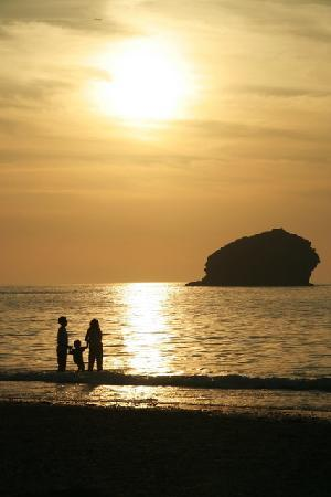 Sunset over Gull Rock at Portreath