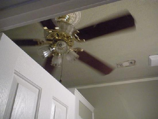 Ceiling Fan In Bathroom And Grody Vent Lurking Behind Picture Of Peace And