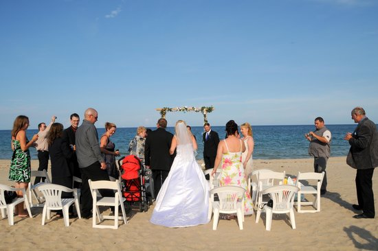 beach wedding picture of sea watch on the ocean fort