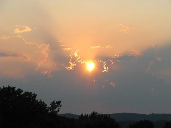 Point Lookout, MO: Sunset from the private balcony of a Skyline Suite.