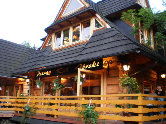 Traditional wooden restaurant on the street in zakopane in the christmas decoration