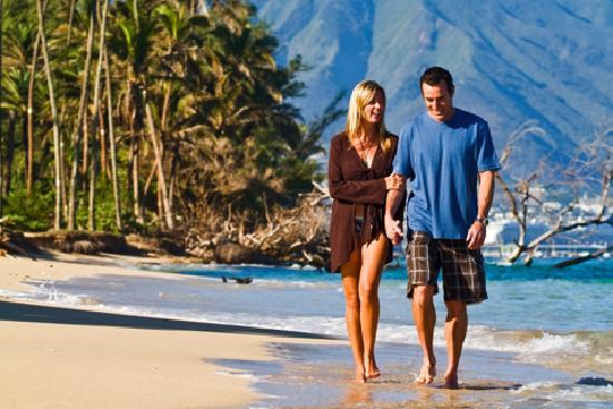 Take a leisurely walk on one of Maui's many white sand beaches.