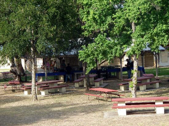 Flying L Guest Ranch: Picnic benches outside main building.