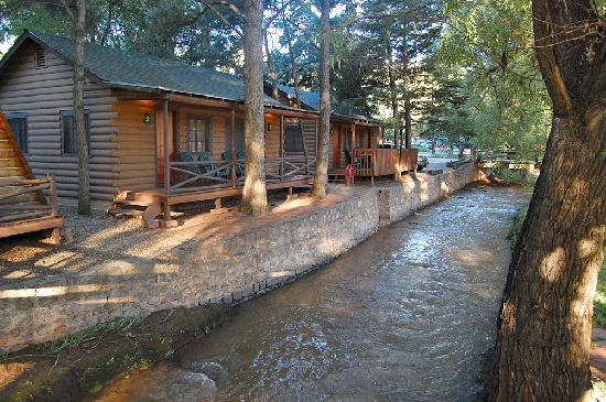 Cabins nestle next to a free-flowing creek flowing from ...