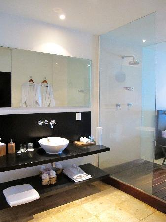 Hotel Secreto: Bathroom with view of walk-in shower and bedroom just beyond.
