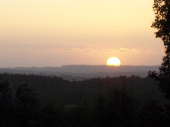 Llanddeiniolen, UK: Sunset from the bottom of the garden overlooking the hills