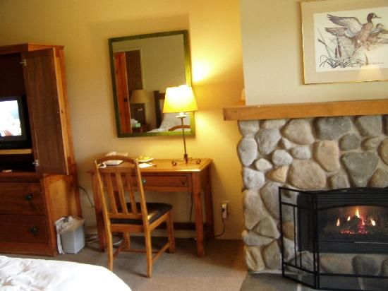 The Riverside Inn: tv armorie, desk and gas fire place