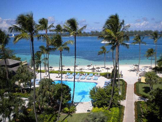 British Colonial Hilton Nassau : A view of the pool and private beach from the 5th floor balcony